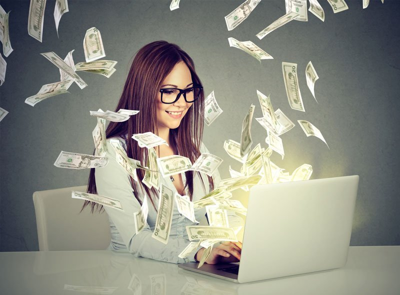 Woman on computer with money